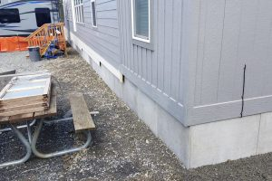 DURASKIRT™ on a manufactured home shown on a sloped lot