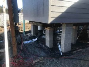 Earthquake tie-downs for mobile homes